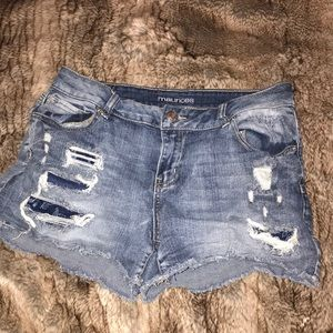 Lightly distressed denim shorts